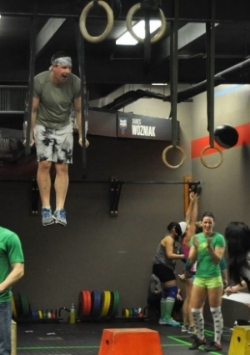 Erin's husband Darryl of CrossFit 716's got his first muscle up in workout  15.3